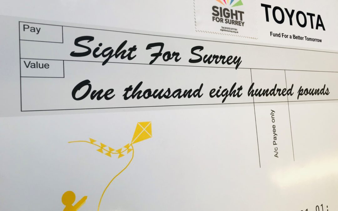 Sight for Surrey receives cheque from Toyota GB