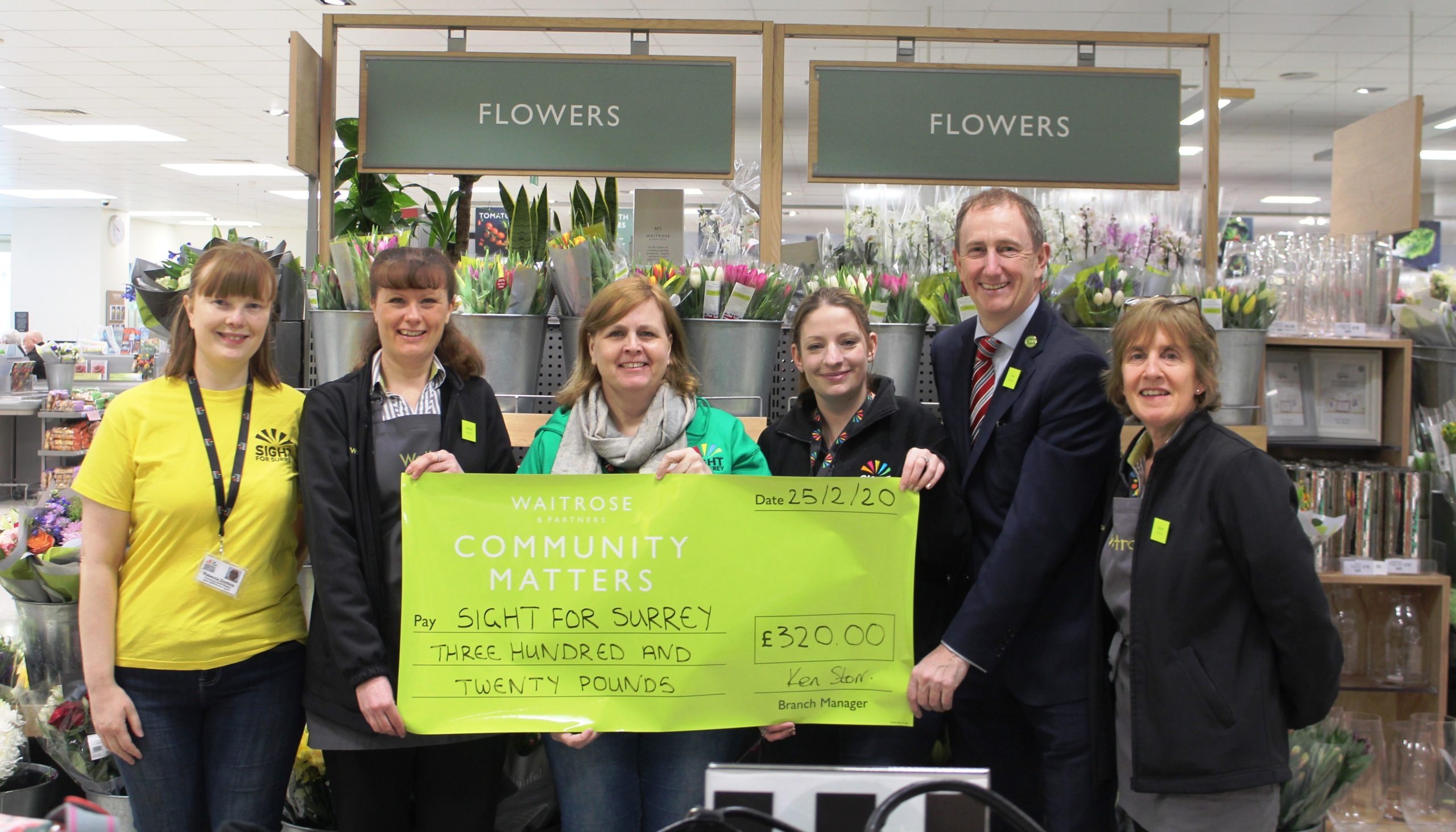 Waitrose Dorking presents cheque to Sight for Surrey